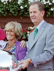 Seth Hancock (right) with long-time partner Adele Dilschneider (left) after Champion BLAME's victory in the 2010 Whitney Handicap.